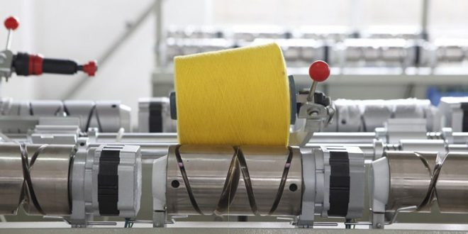 textile winder with yellow cone
