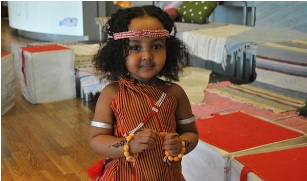 Little Somali girl in Djibouti wearing the traditional guntiino, armlets, headband, henna, and jewellery